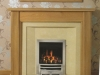Fireplace with Oak Mantel and shaped Marble Set and Living Flame Gas Fire