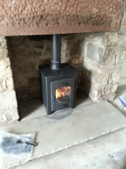 Buget-small-multi-fuel-stove-in-inglenook