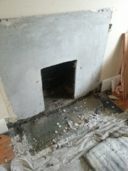 knocking-out-for-cast-iron-fireplace
