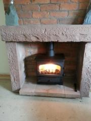 Wood-Burning-Stove-in-old-inglenook