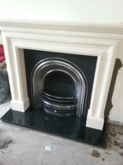 Limestone-Mantel-with-Arched-Cast-Iron-Solid-fuel-Fireplaces